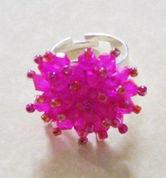 Make a statement and add some glamour with this hot pink crystal bead ring. This ring is hand made from bicone crystal beads which are individually strung onto a silver plated ring which is adjustable to fit most ring sizes. Crystal Beads, Crystals, Organza Gift Bags, Beaded Rings, Hot Pink, Sparkle, Bling, Silver, How To Make
