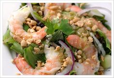 """Lemongrass Shrimp Salad_    The salad combines lettuce, fresh herbs, daikon radish and shrimp with a wonderfully pungent dressing made with lemongrass, ginger, garlic, fish sauce and lime. The recipe is adapted from one we found on a now-defunct food blog called """"Under The Tamarind Trees."""" The blog was a collection of Cambodian recipes compiled by a gentleman that had lived and worked in that country for a number of years - very unique and well done. We're sorry that it's no longer in…"""