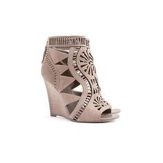 Sergio Rossi Aztec Laser Cut Suede Booties ($870) ❤ liked on Polyvore