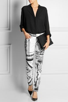 Versus | + Anthony Vaccarello printed mid-rise skinny jeans, The Row blouse, and Gianvito Rossi heels.