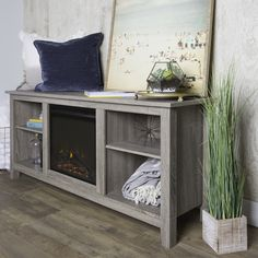 Very stylish fireplace for a TV stand or decor http://amzn.to/2hWxujc