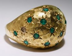 "Lot 193: 18k Gold and Emerald Ring; Dome ring having scattered round cut emeralds; marked ""18k"" inside band"