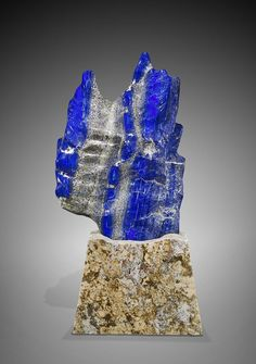 MASSIVE LAPIS LAZULI FREEFORM This exceptional sculpture has been fashioned and polished from one single massive piece of finest Afghan lapis. This superlative specimen boasts the richest deep blue coloring, generously streaked with contrasting calcite and pyrite, approx 37 x 24 x 6 inches / Mineral Friends <3