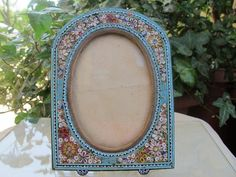 Micro Mosaic frame depicting white and red flowers on a turquoise from chateau on Ruby Lane