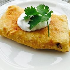 "Chicken Chimichangas with Sour Cream Sauce | ""This was super easy to make and a hit with my family. It has just the right amount of seasoning that brings the taste buds alive!"""