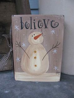 Primitive hand painted vintage reading hard covered book with a great winter snowman design. Simple and primitive. Antique white snowman on a
