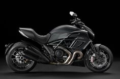 Ducati Diavel Dark Motorcycle looks like the perfect vehicle for Batman. It looks slimmer than previous model Ducati Diavel Strada with total black and sophisticated design. Moto Ducati, Ducati Motos, New Ducati, Ducati Motorcycles, Moto Guzzi, Custom Motorcycles, Cars And Motorcycles, Custom Bikes, Triumph Scrambler