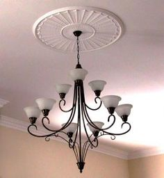 Pressed ceiling and modern light instead of chandelier
