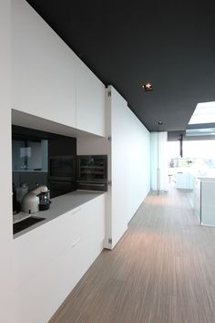 Office at Luxhome, with a hide away kitchen area with a sink and fridge #kitcheninteriordesignmodern