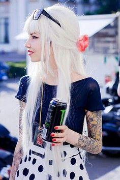 Platinum blonde hair, bangs