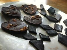 2 variations on the Oh She Glows recipe with cocoa butter. Hearts: 3:1 cocoa powder: carob powder, honey, chopped almonds, sea salt. Quadrilaterals: dark cocoa powder, honey, Grand Marnier liquor, sea salt. Interesting, chewy texture--reminds me of See's scotchmallow.