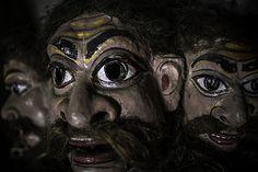 The masks depict Ramayana figures. Shamaguri Satra is famed for mask making in India, Majuli Island, Assam.