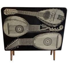 Piero Fornasetti Magazine Stand | From a unique collection of antique and modern magazine racks and stands at https://www.1stdibs.com/furniture/more-furniture-collectibles/magazine-racks-stands/