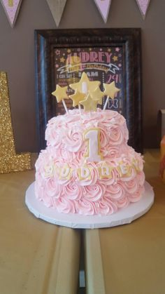 Twinkle tinkle little star cake for First Birthday. Rainbow chip cake with raspberry buttercream filling. Buttercream rosettes with fondant stars and decorations.