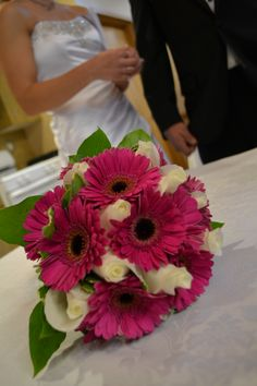 My wedding bouquet. Hot pink Gerbera Daisies and White roses. Very simple.