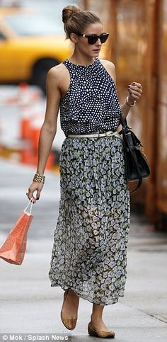 Olivia Palermo's outfit, a loose dotted top and breezy floral print skirt, is a wild clash of patterns