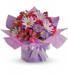 T16-2A Lovely Lavender Present Bouquet, this pretty present is adorned with hot pink spray roses, mini carnations, alstroemeria, daisy and greenery, all wrapped up in the present box. - Timmins Flower Shop