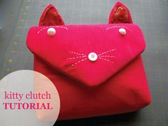 Free patterns and instructions.  DIY Kitty Clutch—the purrfect purse for a cat lover (@ Scathingly Brilliant)