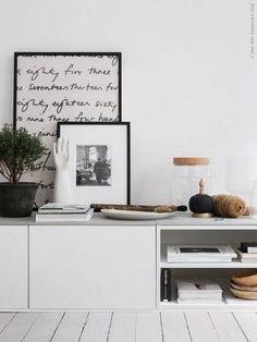 IKEA kitchen units as low-lying bookshelves.
