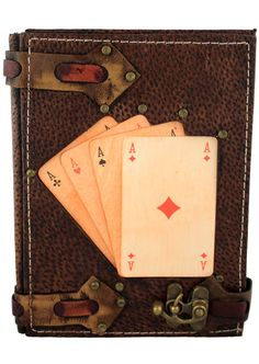 Unique handmade medium size leather journal with four life size Ace playing cards on the front cover. This great piece of art is combined with a Journal which can also be used as a notebook. The paper used in the Journal is top quality Persian Paper and can be used for both sketching and writing.