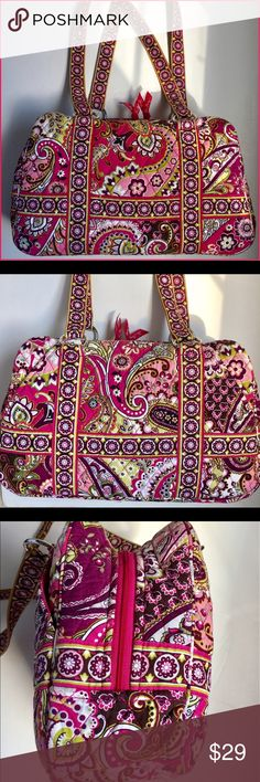Vera Bradley Handbag in Very Berry Paisley Design Beautiful Very Berry Paisley (Retired) design from Vera Bradley. Handbag has double shoulder straps and two outside slant pockets. Several inside pockets with zip top closure. Contrast pattern inside and hard bottom. Excellent condition with no fading. Vera Bradley Bags Shoulder Bags