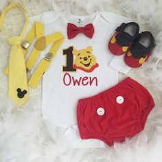 Winnie the Pooh inspired Birthday outfit Set price include top(number, name,design) bottom,Shoes and suspenders  Other pieces not included in this set price.To complete your outfit Please add to other matching items , add on listings are shown as below⬇️  Too add Booties/shoes https://www.etsy.com/au/listing/216709075/shoes-made-to-match-your-harushoneybee?ref=shop_home_active_9  Please measure your baby feet before ordering. Sizes are as follows: size 11 are inter length 10.5 cm about 4.1…
