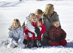 Crown Prince Willem-Alexander and wife  Maxima with their 3 daughters have a cuddly time in the snows of Austria on their annual ski vacation  2/18/13