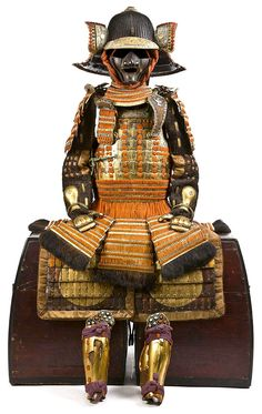 Warabe Gusoku. (Boys Armour) Edo Period, 19th century Lacquered gold and laced in bright orange and comprising a sixty-two plate ko-boshi kabuto mounted on the top with a four-stage gilt and silver tehen kanamono decorated with swirling clouds...