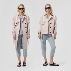 Modular trench coat constructed from waterproof double-faced cotton blend that features removable and variable details, such as zip-off lower portion, asymmetric panels and oversized buttons.