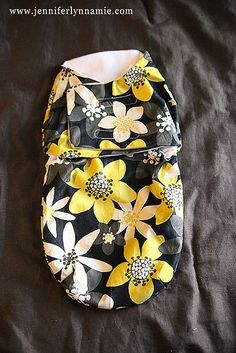 Two of my cousins gave birth last month and I wanted to make them a little something special but useful. I had come across a pin on Pinterest linking me HERE for a DIY Baby Wrap and it turned out the be a fairly simple project once I completed the firs
