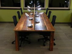Desk with metal base and reclaimed lumber