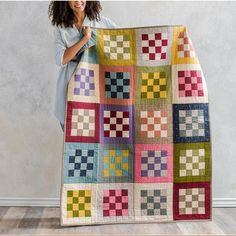 Checkerboard Tailors Tack Quilt by Craftsy. Jelly roll strip quilt using boundless fabrics. affiliate link.