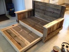 Doggie day bed with trundle...made from pallets and scrap wood More