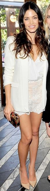 White lace shorts, white top, blazer, and floral print clutch handbag
