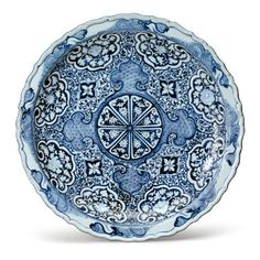 Property From a Private Collection A Rare Molded Blue and White Barbed Rim Dish Yuan Dynasty, 14th Century Estimate:  200,000 - 300,000 USD