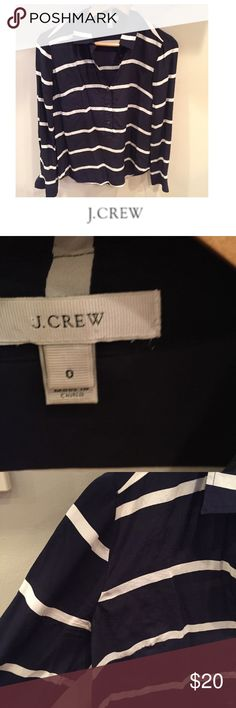 J. Crew Navy Blue & Cream Striped Popover J. Crew Navy Blue & Cream Striped Popover. Missing material tag, but is a Silk Blend. 16 inch bust. 25 inches long. Half buttons. Gently worn. Great condition. Feel free to make an offer or bundle & save! J. Crew Tops Blouses