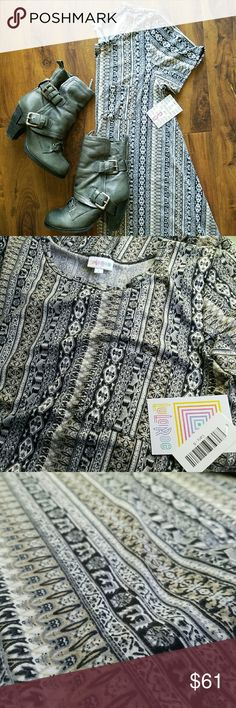 S Carly Lularoe- USA Made! BNWT small Carly in gorgeous gray tone stripe print. Legging material... And MADE IN THE USA!  Photos taken in natural light. Questions? Please ask! 👍 Smoke free home.   Please no rude comments... You will be reported! This should be a place of positivity. If you don't agree with pricing please make an offer. LuLaRoe Dresses High Low
