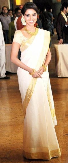 Asin in a traditional Kerala kasavu saree. Gorgeous simplicity!