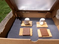 Solar oven box with marshmallows, chocolate, and graham crackers.