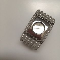 WATCH | Pearl Fancy Cuff Bangle Watch This fashion watch looks like a bracelet, but offers the functionality of a watch! Pearl cuff bangle, with silver tone watch face & details. In near new condition. Wear alone or stack with other bracelets for a unique statement. *Needs new battery* Accessories Watches