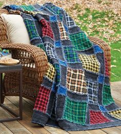 Easy to make throw size masculine flannel rag style quilt an assortment of plaids that uses the quilt as you go technique.