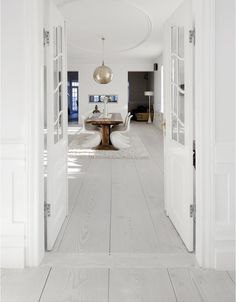 Wide plank, white-washed floors are a great alternative to the modern, ebony floors that are so popular.