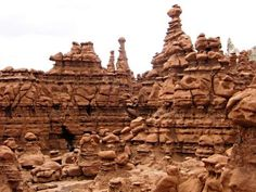 """Goblin Valley State Park is a state park of Utah, USA. Its eminent feature is its thousands of hoodoos and hoodoo rocks, referred to locally as """"goblins"""", which are formations of mushroom-shaped rock pinnacles, some as high as several meters. Utah Vacation, Vacation Trips, Vacation Ideas, Oh The Places You'll Go, Places To Visit, Goblin Valley, Great Memories, State Parks, Monument Valley"""