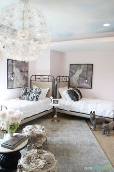 Girls bedroom with pale pink walls, cloudy ceiling and IKEA chandelier