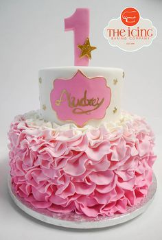 Ruffled pink and gold first birthday cake