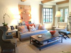 living room - exposed beams, cool coffee table