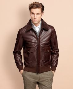This men's brown leather bomber jacket made from genuine leather with a cotton canvas lining. Hidden zip-front with removable shearling collar. 1940s Mens Fashion, Modern Mens Fashion, Brown Leather Bomber Jacket, Leather Jacket Outfits, Leather Jackets, Mens Clothing Guide, Mens Clothing Styles, Men's Clothing, Revival Clothing