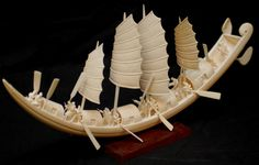 Ivory elephant tusk boat - hand carved in China. This was once their tusk... Many ivory ornaments like this are highly coveted!