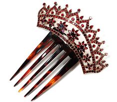 Bohemian Garnet Tiara Comb.  Date: Circa 1880.    Stately and grand, this tortoiseshell and garnet hair comb is larger than most with its five buttery caramel and cocoa coloured prongs. Even the Bohemian garnets have a large table (flat top surface) with faceted sides and base as compared to the usual small almost rose cuts used in some of the garnet pieces of the time.