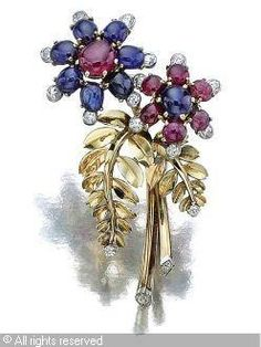 CARTIER (France),CLIP; Ruby, sapphire and diamond .